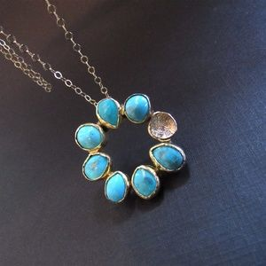 14k gold pendant set with Turquoise and diamonds.